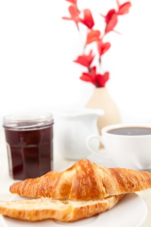 bisected: Breakfast with a bisected croissant  against white background