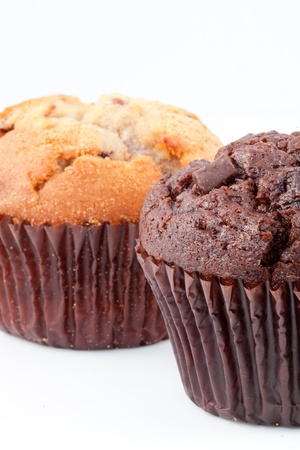 Close up of two muffins against a white background photo