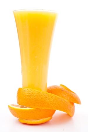 orange peel skin: orange peel at the base of a glass against white background