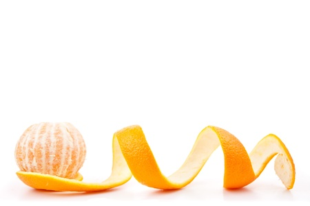Orange posed on a orange peel against white background photo