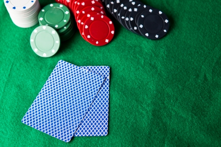 Cards and chips on the green mat Stock Photo - 16208950