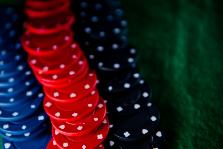 Heap of poker chips on the green mat Stock Photo - 16201028