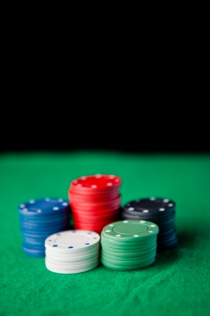 Gambling chips  against a black background Stock Photo - 16200698