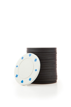 tokens: Black and white poker tokens against a white background