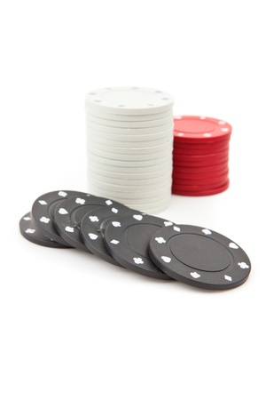 tokens: Poker tokens piled up together against a white background