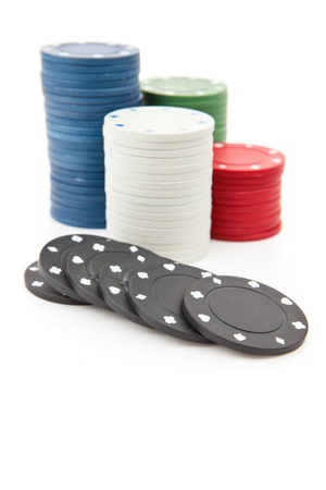 tokens: Many poker tokens piled up against a white background Stock Photo