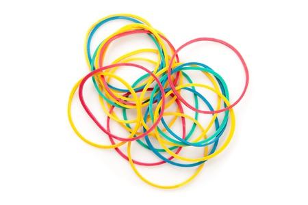 Large group of muti coloured elastics against a white background Stock Photo - 16199244
