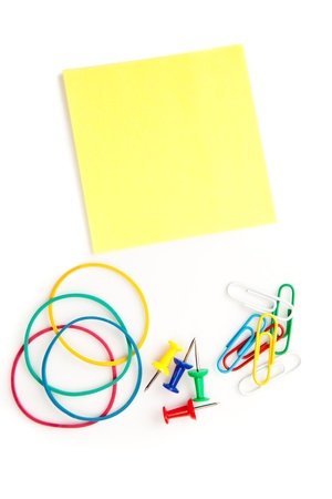 whose: Stationery whose pushpins elastics paperclips adhesive notes Stock Photo