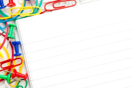 muti: Notepad with large group of muti coloured stationery against a white background Stock Photo