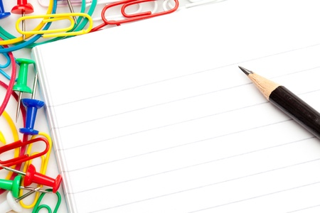 Notepad with large group of muti coloured stationery and a pencil against a white background Stock Photo - 16199243