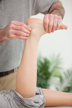 ligaments: Masseur holding a tendon in his office