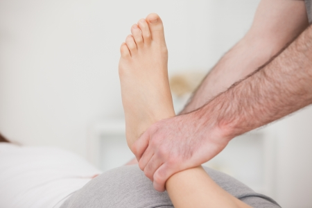 Physiotherapist manipulating an ankle indoors Stock Photo - 16204212