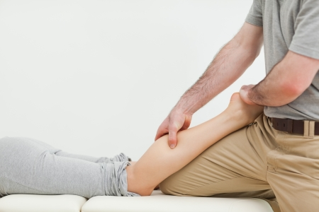 Close-up of a woman lying while being massaged in a room Stock Photo - 16204317