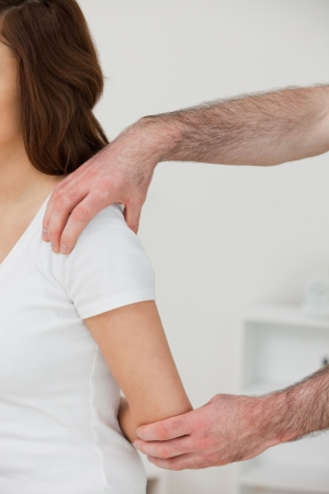 Close-up of a doctor examining the shoulder of a patient in a room Stock Photo - 16207891