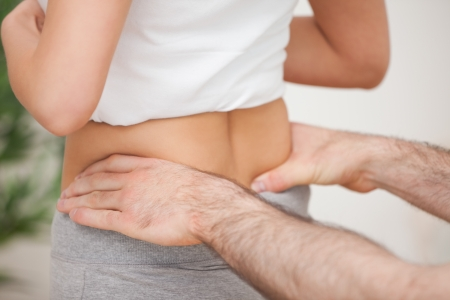 Close-up of a man touching the hips of a woman in a room Stock Photo - 16207535