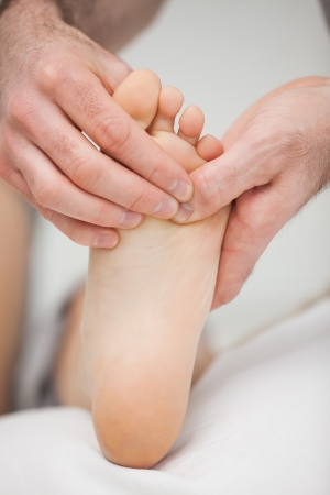 chiropodist: Foot being touched by a chiropodist in a room
