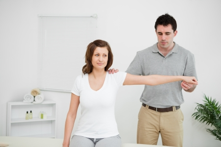 Seus practitioner extending the arm of a patient in a room Stock Photo - 16204439
