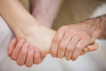 Foot being held by a practitioner indoors Stock Photo - 16206624