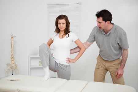 Brunette woman doing stretching exercises in a room Stock Photo - 16205101
