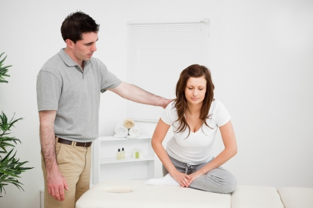 Peaceful woman doing stretching exercises with a doctor in a medical room Stock Photo - 16204775