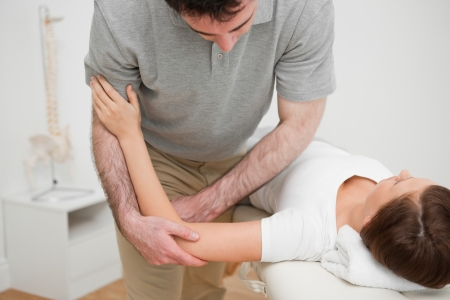 Woman lying while being massaged in a room Stock Photo - 16207837