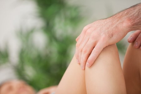 abductor: Legs being held by a practitioner indoors Stock Photo