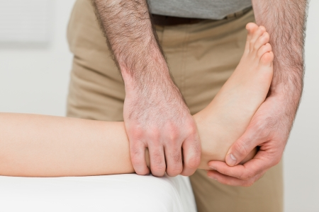 ligaments: Ankle of a patient being manipulated in a room