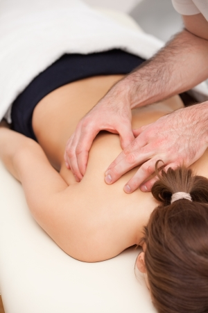 Woman lying on the table while being massaged in a room Stock Photo - 16207650