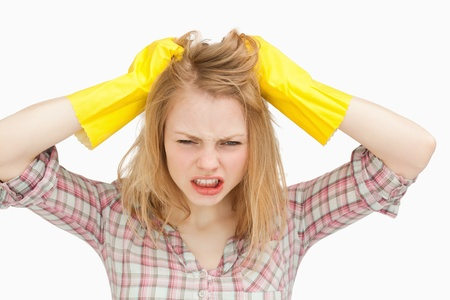 Woman pulling her hair against white background