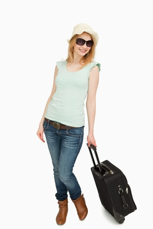 boater: Woman holding a suitcase while standing against white background
