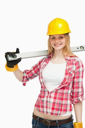 spirit level: Cheerful woman holding a spirit level Stock Photo