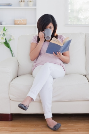 Woman holding a mug in a living room photo