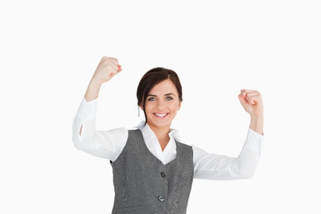 Young woman in suit raising her fists against white background Stock Photo - 16200656