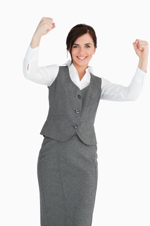 Smiling businesswoman raising her fists against white background Stock Photo - 16203537