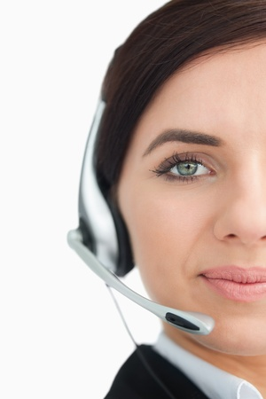 Blue eyed businesswoman with headset against white background photo