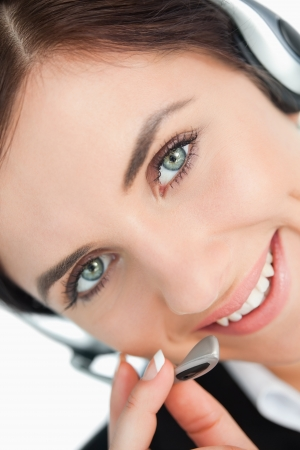 Green eyed woman with headset in close-up photo