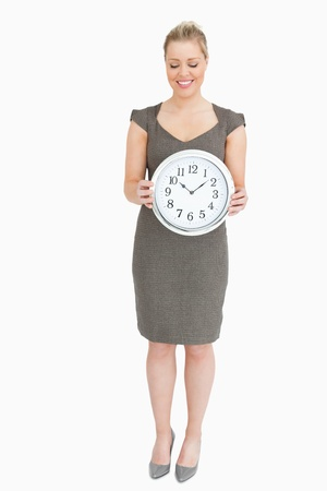 Woman showing a clock against white background Stock Photo - 16200137
