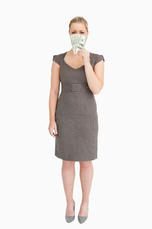 Businesswoman showing banknotes against white background Stock Photo - 16201883