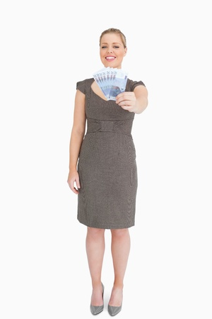 Woman showing euros banknotes against white background Stock Photo - 16201797