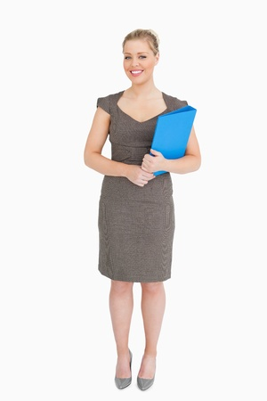 Woman holding a blue binder against white background photo