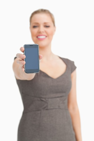showed: Smartphone being showed by a woman against white background Stock Photo