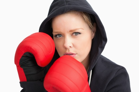 Woman boxing against white background photo