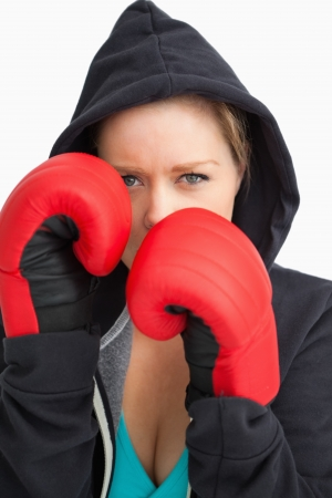 Pretty woman boxing against white background photo