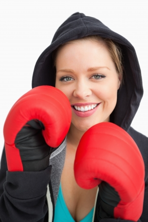 Pretty smiling woman boxing against white background photo