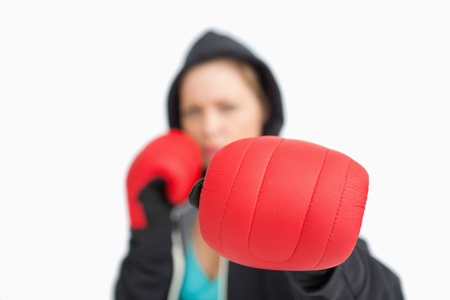 Woman fuzzy showing a boxing glove against white background photo