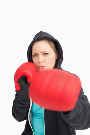 Concentrated woman boxing against white background Stock Photo - 16202029