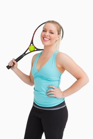 health fair: Woman holding a racquet behind her head against white background Stock Photo