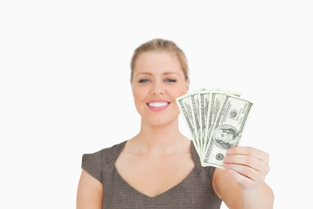 Woman showing dollars banknotes against white background Stock Photo - 16200694