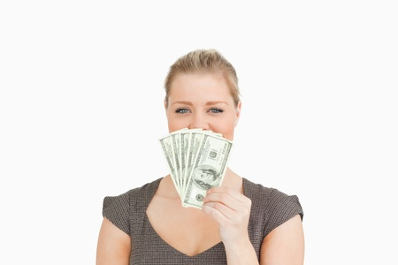 Woman hiding her mouse with dollars banknotes against white background Stock Photo - 16201143