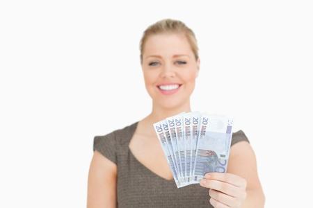 Pretty woman showing euros banknotes againsta white background Stock Photo - 16200388